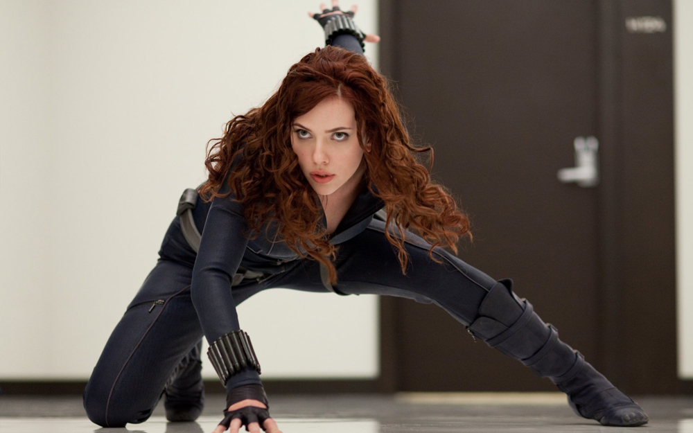 Black Widow crouches down on a floor in The Avengers