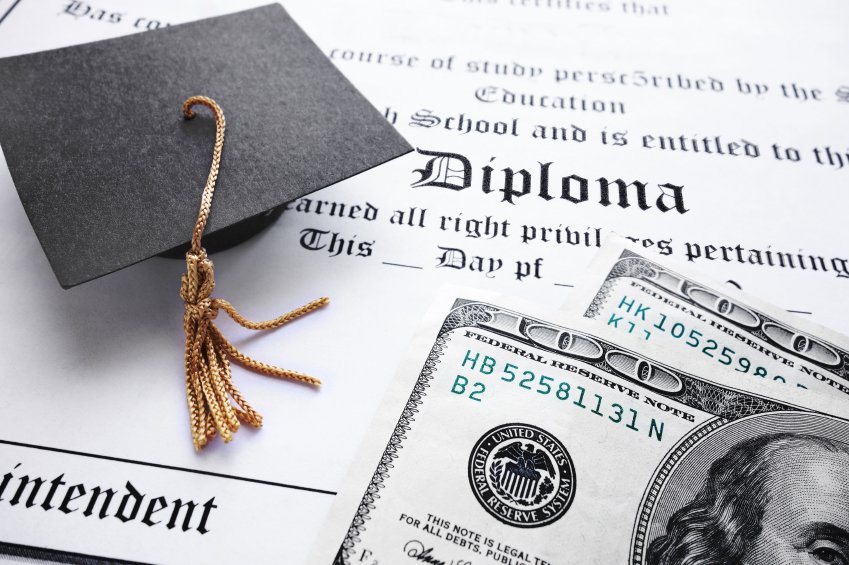 graduation cap and diploma with two $100 bills