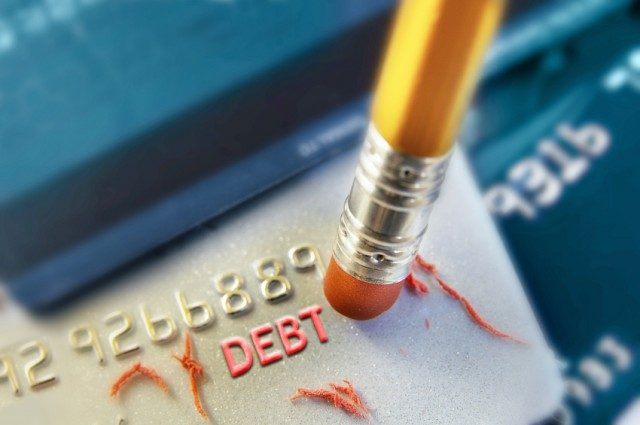 pencil and debt on credit card