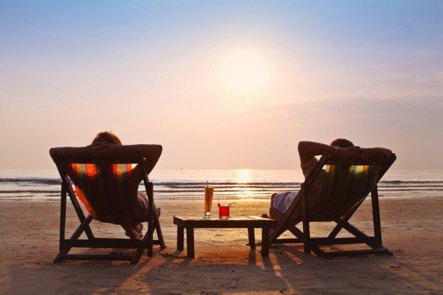 retired couple on beach