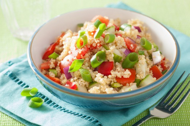 couscous salad with tomato, cucumber, onion, chives