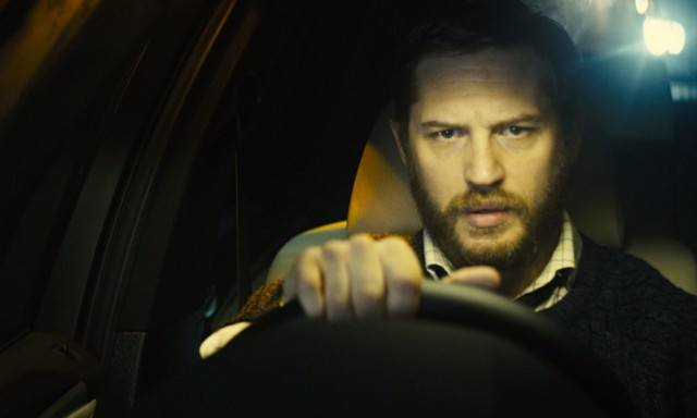 Tom Hardy holds on to the starring wheel of a car