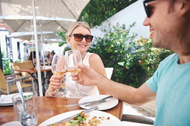 man and woman dine outdoors