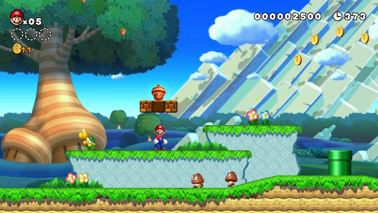 Mario stands above Goombas and uncorks an acorn from a question block.