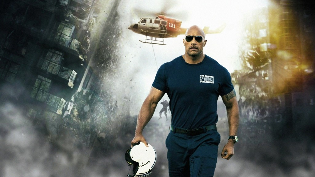 Dwayne Johnson is holding a white helmet as rubble and a helicopter is behind him.