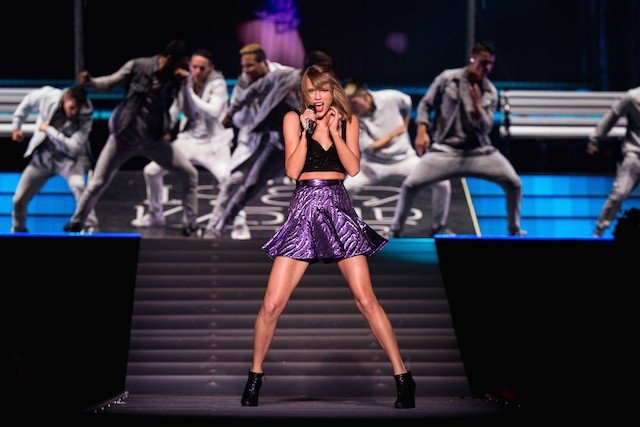 Taylor Swift performs on stage.