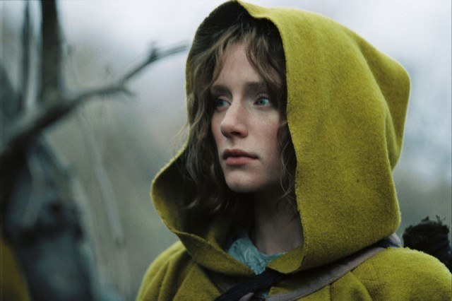 Bryce Dallas Howard wears a yellow hooded cape in a scene from The Village