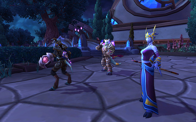 Elves and dwarfs stand in a lobby in World of Warcraft.