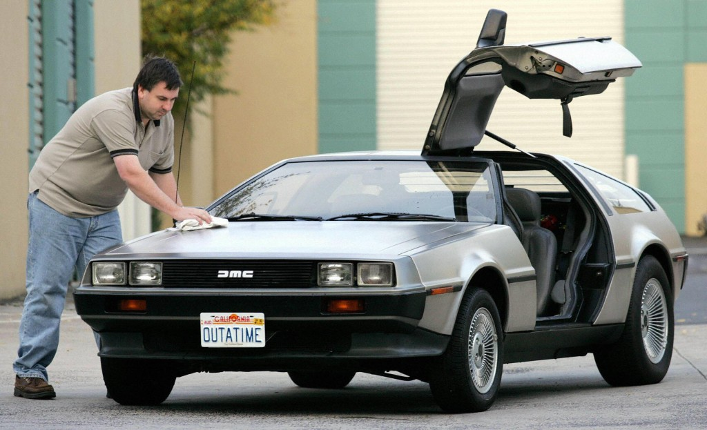 Wayne Gillard polishes up his 1981 DeLorean DMC 12, one of only six in Australia and up for auction at a novelty auction, seen in this 15 July 2004 file photo in Melbourne. John DeLorean, an innovative automaker who left a promising career in Detroit, Michigan to develop the short-lived gull-winged sports cars died 19 March, 2005 in a New Jersey hospital at the age of 80 due to complications of a recent stroke.