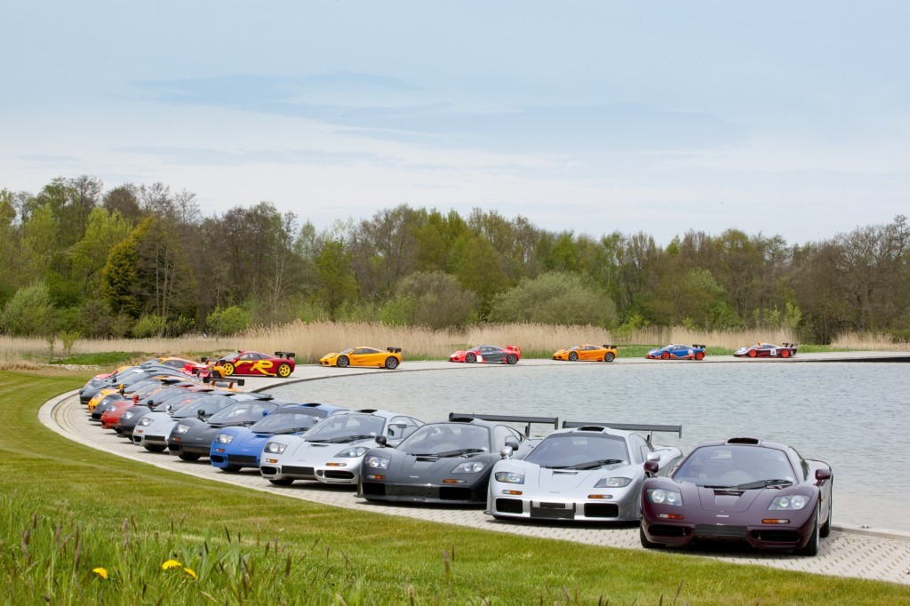 McLaren F1s parked around the edge of a pond at the McLaren Technical Center