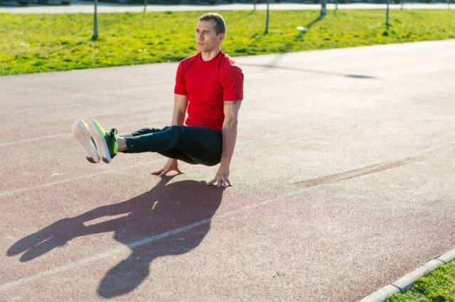 Man doing a L-sit for exercise
