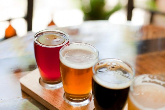 beer flight served on a wooden board