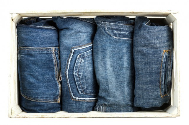 Pairs of blue jeans rolled up