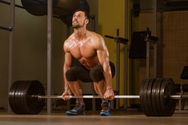 male athlete in the gym preparing for a deadlift