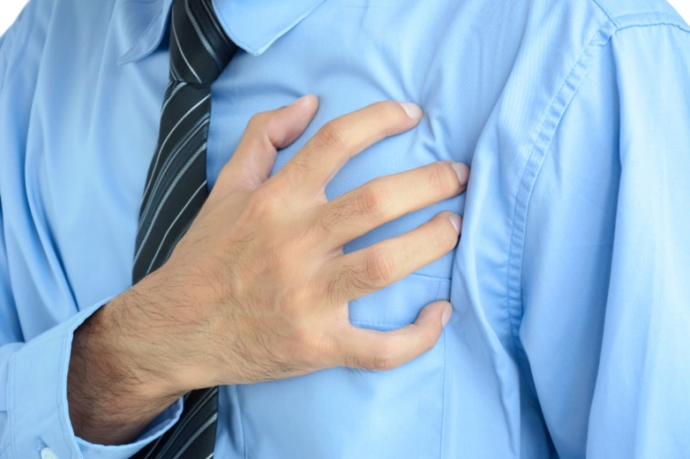 Man clutching his heart