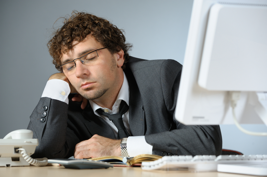 man sleeping at his desk