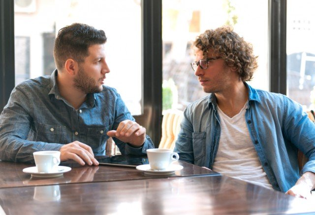 two young men meeting in a coffee shop