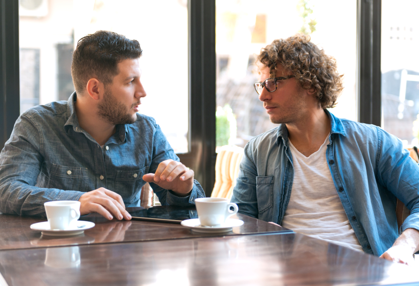 men talking over coffee