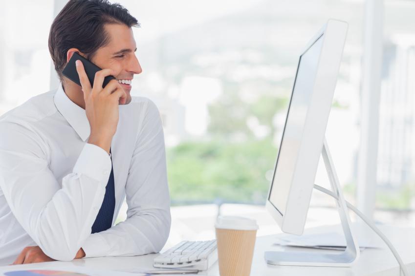 man on phone at computer