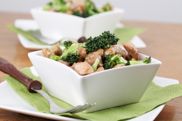 white bowl filled with chicken and broccoli stir-fry