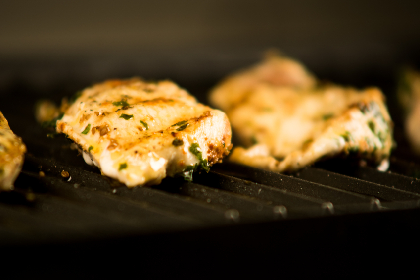 Chicken breasts on a grill