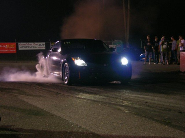 A Nissan 350Z drag car does a burnout at the race track in Cincinnati, Ohio