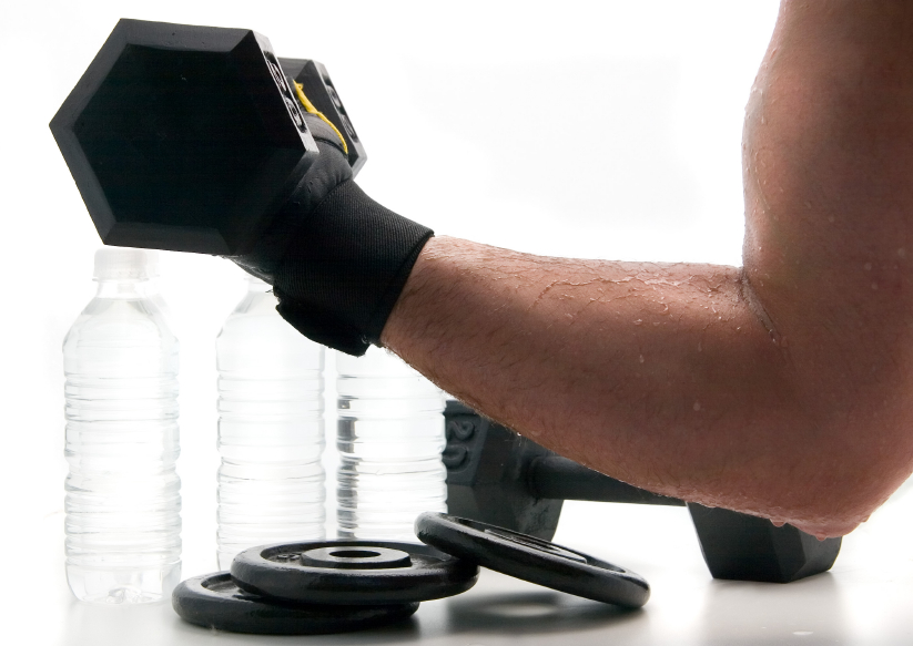 a man with dumbbells and water