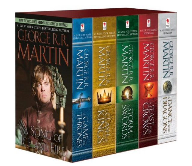 A collection of Game of Thrones books, each a different color