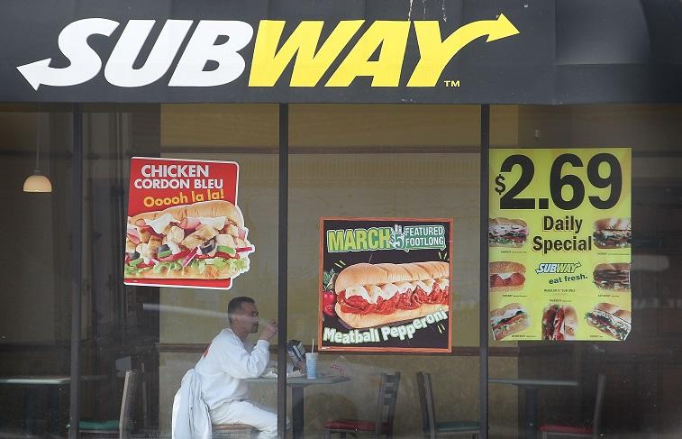 A man eating fresh at Subway