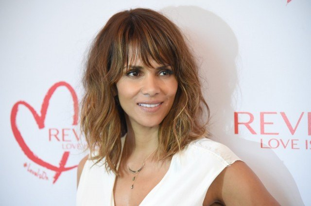 Halle Berry walks the red carpet at a Revlon event