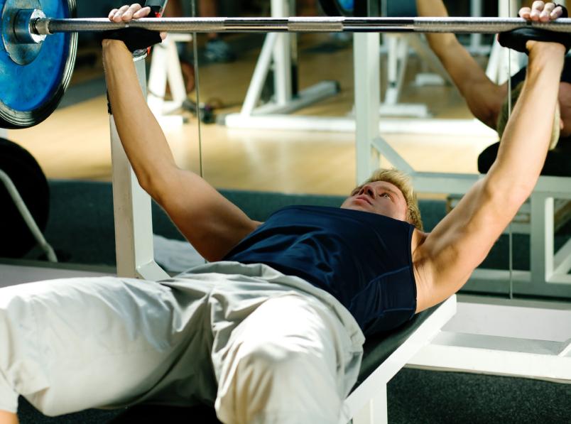 A man performs a bench press lift