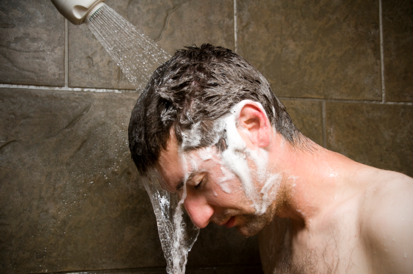 a man showering, close-up