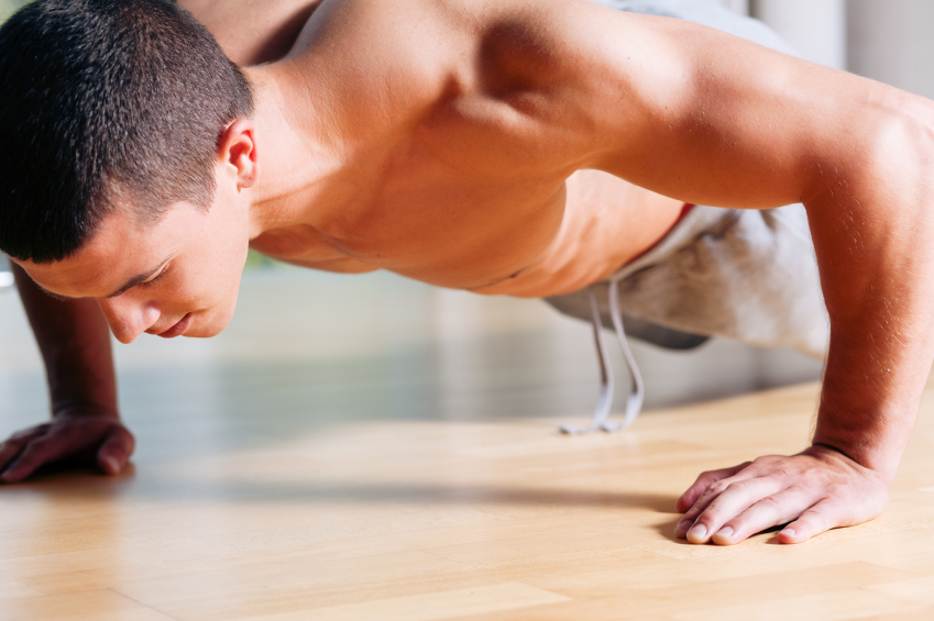 Man performing wall push-ups