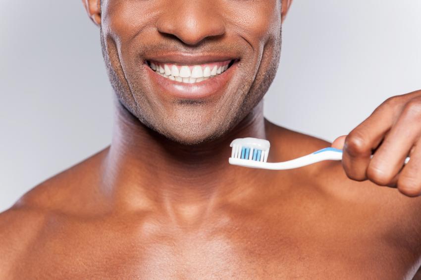 man getting ready to brush his teeth