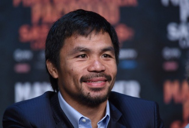 Manny Pacquiao smiles during a media event