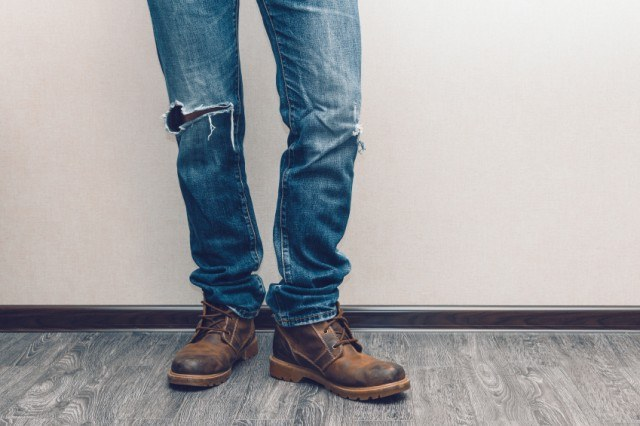 Ripped blue jeans with boots