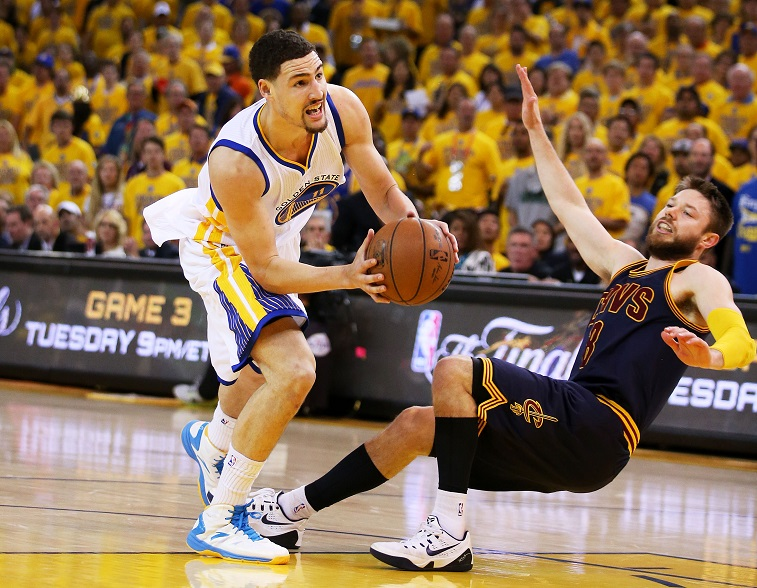 Dellavedova falls down during Game Two of the 2015 NBA Finals at ORACLE Arena on June 7, 2015 in Oakland, California.
