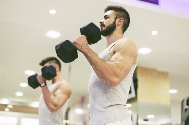 man building muscle at gym