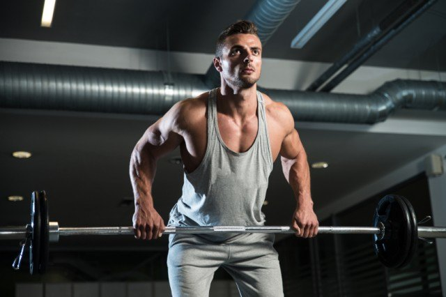 Man in position for bent over row exercise