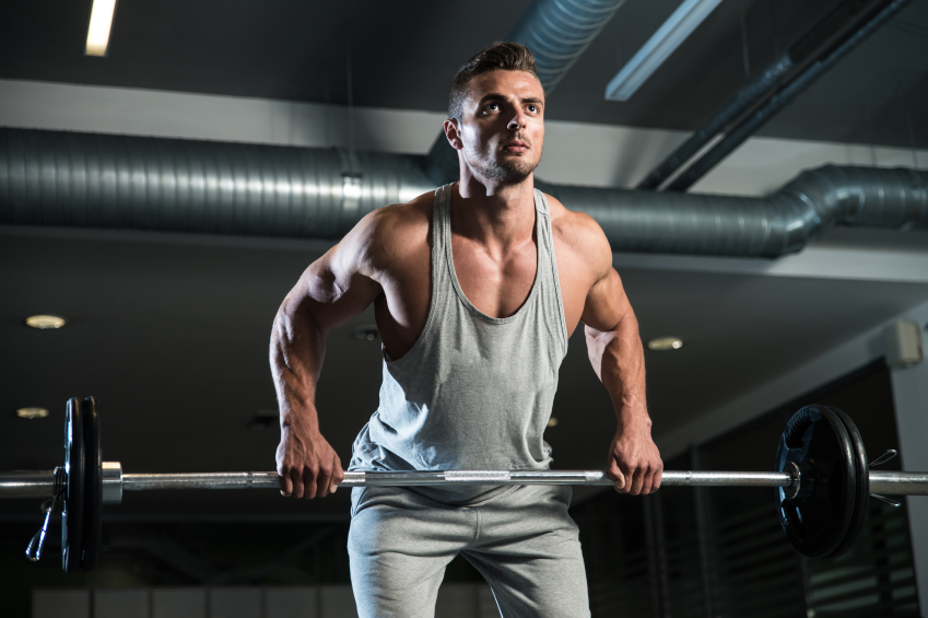 A man lifting weights at a fast pace to increase stamina