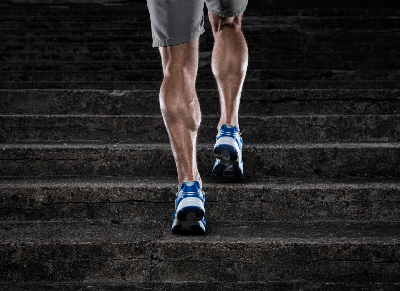 Muscular man running up stairs