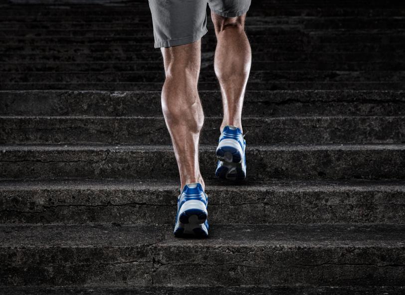 Muscular man running up stairs