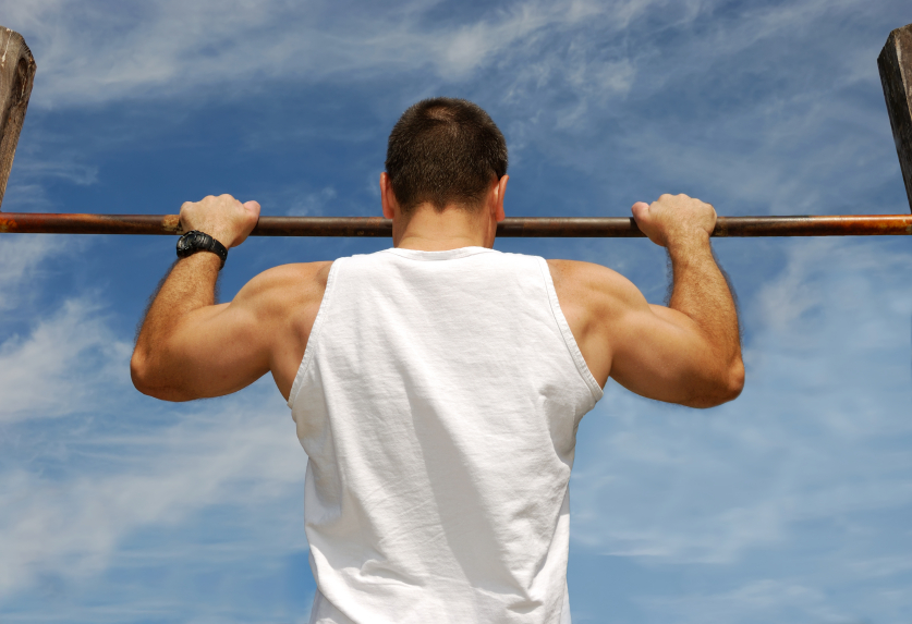 Man doing pull-ups for exercise