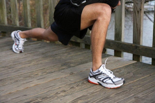 close-up of a man's legs as he lunges