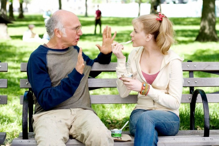 Larry David is talking to Nicole Patrick as she eats yogurt in 'Whatever Works.'