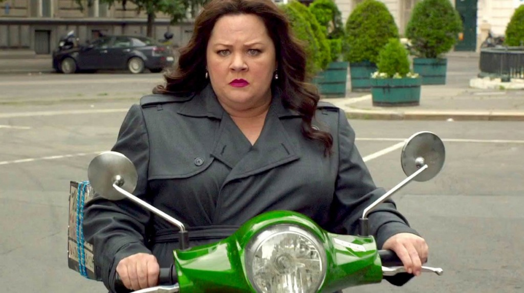 Melissa McCarthy is on a green motorcycle in Spy.