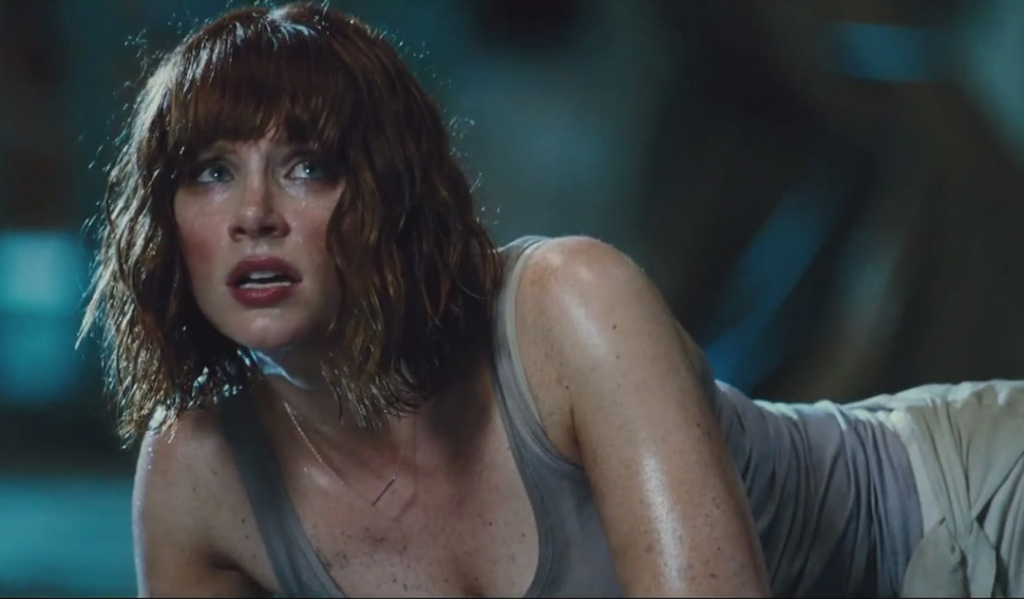 Bryce Dallas Howard lays on the ground in Jurassic World