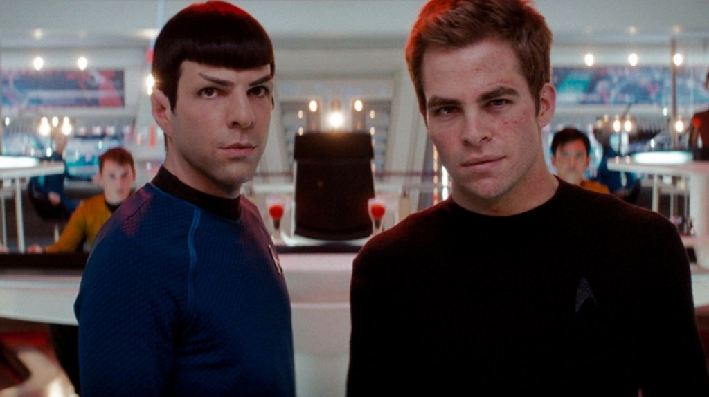 Spock and Kirk look dramatically into the camera on the bridge of the Enterprise
