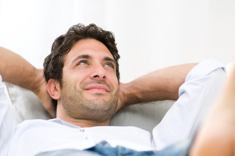 Smiling-young-guy-relaxing-e1435795919229.jpg