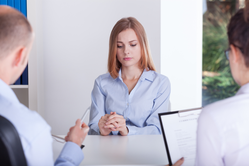a woman with awkward body language in a job interview
